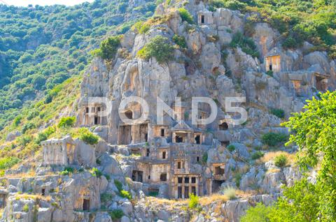 Stock photo of Ancient lycian Myra rock tomb ruins at Turkey Demre