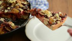 Take a piece of plum cake of crumpet with a cake fork on a plate Stock Footage