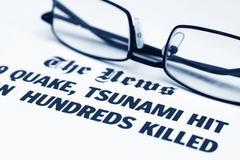 the tsunami news - stock photo