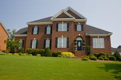 Upscale brick home - stock photo