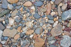 River pebbles background - stock photo