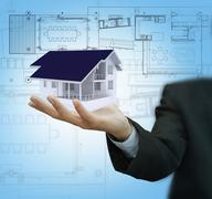 businessman present house model and plan on touch screen - stock illustration