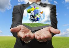 Stock Illustration of businessman show green earth concept