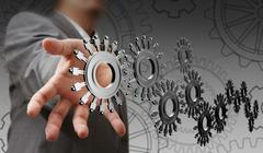 Stock Illustration of businessman hand shows people cogs