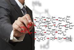 chemist draws a molecular structure - stock illustration