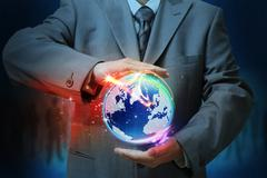 Stock Illustration of businessman holding a glowing, connected,as concept
