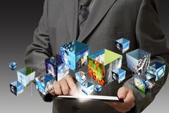 Business hand holding a touch pad computer and 3d streaming images Stock Illustration