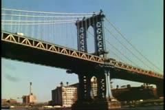 Circle Line boat ride under Manhattan Bridge up East River New York City Stock Footage