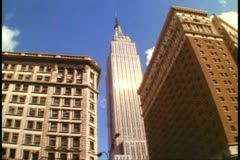 The Empire State Building, New York City, no people, wide shot, pan right Stock Footage