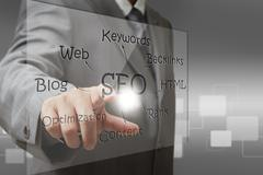business man hand point on seo diagram screen - stock illustration