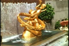 Prometheus Fountain, Rockefeller Center, New York City, gold, no people Stock Footage