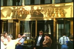 Trump Tower, Fifth Avenue, New York City, with crowd and doorman Stock Footage