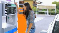 Woman getting upset about gas price at gas station Stock Footage