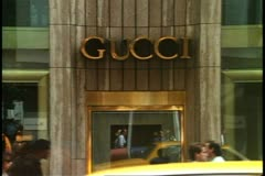 Gucci Store, Fifth Avenue, New York City, crowd and taxis pass in front Stock Footage