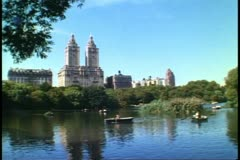 Central Park, New York City, lake, rowboats, San Remo Apartments - stock footage