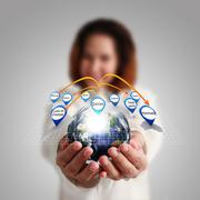 "businesswoman hand holds globe and social network""elements of this image furn - stock illustration"