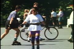 Couple with bicycles walking, Central Park, New York City, 1993 Stock Footage