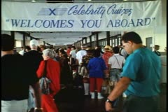 Embarkation hall, New York City, Celebrity Cruises, crowd milling, 1993 Stock Footage