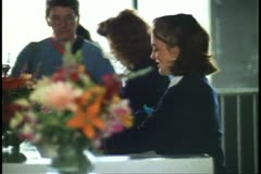 Female agent processing cruise ship tickets, 1993, New York City Stock Footage