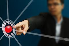 Stock Illustration of business man pressing on target