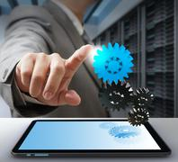 Stock Illustration of business man touch on gear as computer solution concept