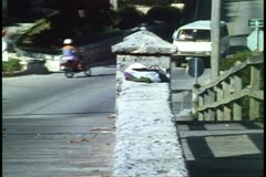 Moped, motor scooter, and cars on small bridge  near Somerset, Bermuda Stock Footage
