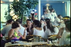 Crowd seated in casual restaurant on a cruise ship, the MV Horizon Stock Footage