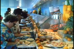 Lunch buffet with crowd and chefs on a cruise ship, the MV Horizon Stock Footage
