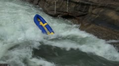 An abandoned raft stuck in river rapids - stock footage