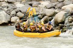 A Group Of Men And Women With A Guide White Water Rafting On The Pastaza River Stock Photos