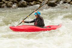Stock Photo of An Active Kayaker On The Rough Water