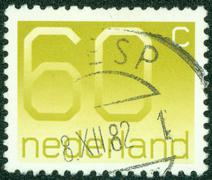 Stamp printed in the Netherlands shows numeral ordinary gum, circa 1976. Stock Photos