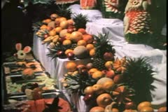 Island Party at night, buffet, carved melons, cruise ship in Bermuda Stock Footage