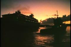 Cruise ship MV Horizon at dawn, sunrise, tugboat, Hamilton, Bermuda Stock Footage
