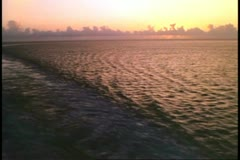 Atlantic Ocean, wake of cruise ship, gentle, pinkish, yellow light Stock Footage