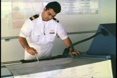 Bridge of cruise ship, navigator, works with charts, Atlantic Ocean - stock footage