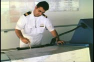 Bridge of cruise ship, navigator, works with charts, Atlantic Ocean Stock Footage