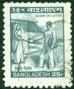 Stamp printed in Bangladesh shows image of the delivery of a letter, circa 2006 Stock Photos
