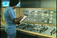 Engine room, cruise ship, Atlantic Ocean, control room, man, clipboard Stock Footage
