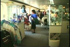 Shop and clerk, cruise ship, MV Horizon, Atlantic Ocean Stock Footage