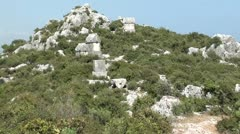 Simena Tombs on hill zoom in Stock Footage