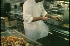 Cruise ship galley, kitchen, MV Horizon, Atlantic Ocean, cutting vegetables Stock Footage