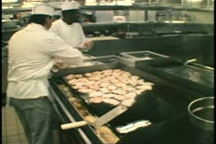 Cruise ship galley, kitchen, MV Horizon, Atlantic Ocean, grill, chicken - stock footage