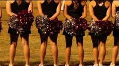 High School Cheerleaders Watch Game Stock Footage