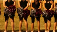Stock Video Footage of High School Cheerleaders Watch Game