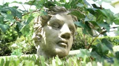 Creepy Statue head coming out of the grass Stock Footage