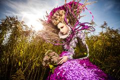 Dramatized image of sensual girl symbolizing autumn. Art Fashion outdoor photo. Stock Photos