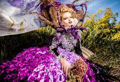 Dramatized image of sensual girl symbolizing autumn. Art Fashion outdoor photo. - stock photo
