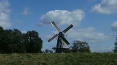Windmill on dyke Stock Footage