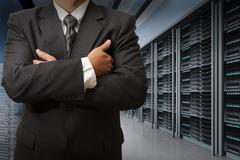 Stock Illustration of business man engineer in data center server room